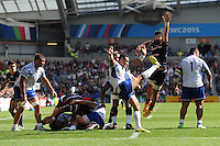 Kahn Fotuali'i of Samoa sends up a box kick as Danny Barrett of USA attempts to block during Match 6 of the Rugby World Cup 2015 between Samoa and USA - 20/09/2015 - Brighton Community Stadium, Brighton <br /> Mandatory Credit: Rob Munro/Stewart Communications