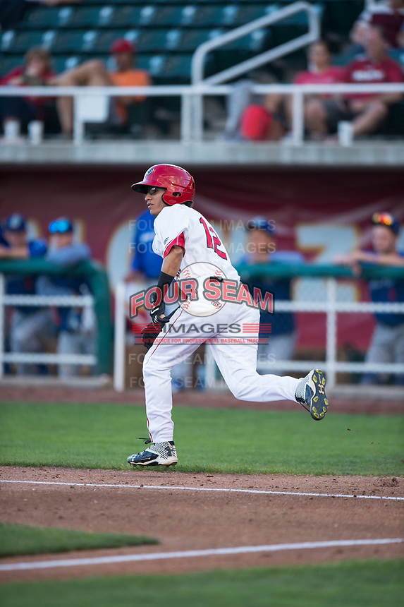 Orem Owlz right fielder Rayneldy Rosario (12) runs to first base during a Pioneer League game against the Ogden Raptors at Home of the OWLZ on August 24, 2018 in Orem, Utah. The Ogden Raptors defeated the Orem Owlz by a score of 13-5. (Zachary Lucy/Four Seam Images)