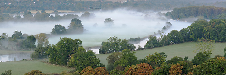 Autumn dawn over the River Thames looking upstream from an elevated position near Mapledurham, Berkshire, Uk