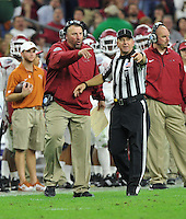 NWA Media/Michael Woods --12/29/2014-- w @NWAMICHAELW...University of Arkansas coach Bret Bielema talks with the official during the 3rd quarter of their 31-7 win over the University of Texas at the Texas Bowl Monday night at  NRG Stadium in Houston.