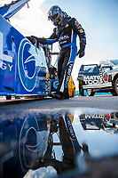Jul 10, 2020; Clermont, Indiana, USA; NHRA top fuel driver Tony Schumacher prepares to climb into his dragster during testing for the Lucas Oil Nationals at Lucas Oil Raceway. This will be the first race back for NHRA since the COVID-19 pandemic. Mandatory Credit: Mark J. Rebilas-USA TODAY Sports
