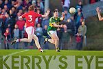Daithi Casey of Kerry hand passes the ball in action against Cork in the Munster U21 Football Championship Final held on Wednesday night in Pairc Ui Rinn Cork.