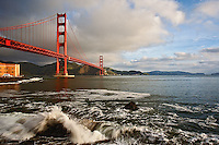 Golden Gate Bridge and crashing surf from Fort Point, a National Historic Site, San Francisco, California