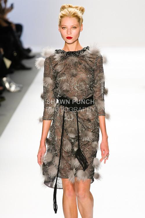 Vika Falileeva walks the runway in a Luca Luca Fall 2011 outfit, designed by Raul Melgoza, during Mercedez-Benz Fashion Week, February 10, 2011