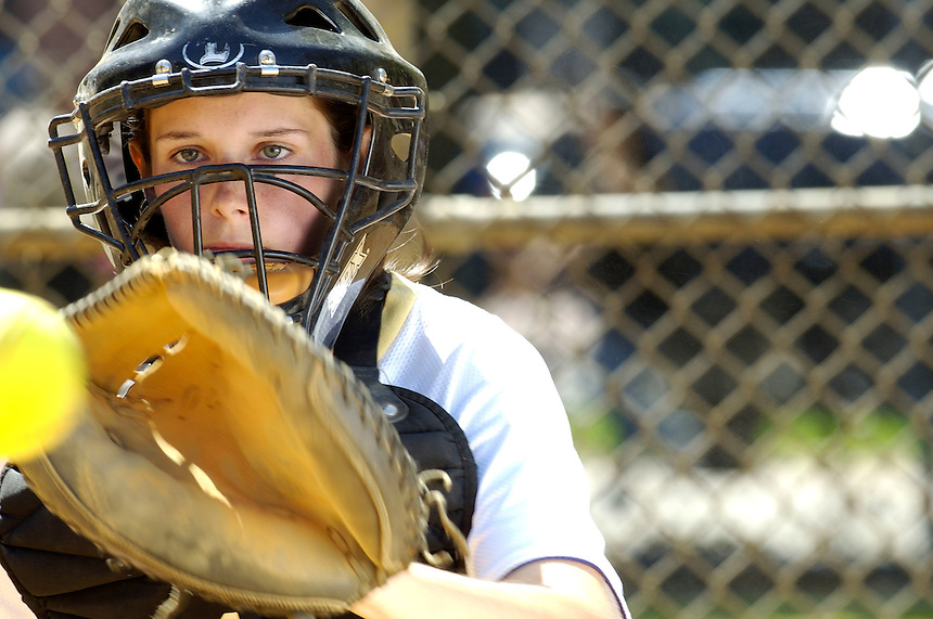 Athletics, a softball player plays the position of catcher.