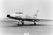 "The F-100 ""Super Sabre"" was the United States Air Force's (USAF) first operational aircraft capable of flying faster than the speed of sound (760 miles per hour) in level flight. It made its initial flight on May 25, 1953 and the first production aircraft was completed in October 1953. North American built 2,294 F-100s before production ended in 1959.   Designed originally to destroy enemy aircraft in aerial combat, the F-100 later became a fighter-bomber. It made its combat debut during the Vietnam conflict where it was assigned the task of attacking such targets as bridges, river barges, road junctions, and areas being used by infiltrating enemy soldiers. .Credit: U.S. Air Force via CNP"