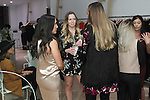 Guests conversing at the 3rd Annual Wives' Holiday Soiree at Totokaelo in SOHO on December 9, 2015.