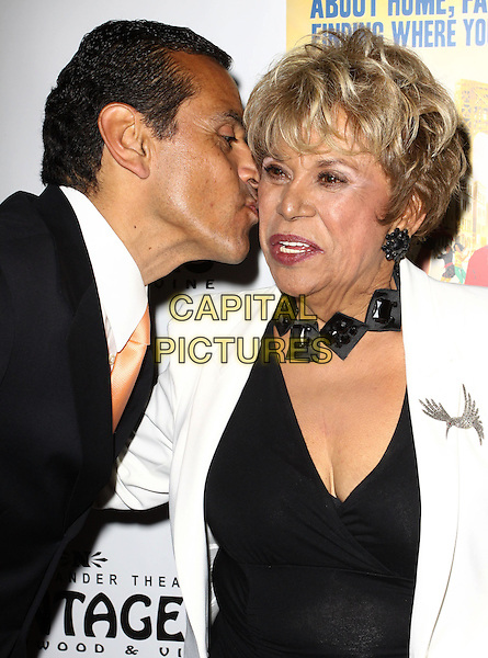 "LA Mayor ANTONIO VILLARAIGOSA & LUPE ONTIVEROS.Broadway Musical Los Angeles premiere Of  ""In the Heights"" held at The Pantages Theatre, Hollywood, CA, USA..June 23rd, 2010.half length black white jacket necklace cleavage profile kiss kissing cheek  top clutch bag suit.CAP/ADM/KB.©Kevan Brooks/AdMedia/Capital Pictures."
