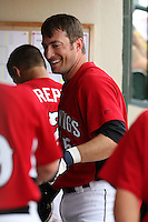May 2, 2010:  Matt Macri of the Rochester Red Wings in the dugout after hitting a home run during a game vs. the Durham Bulls at Frontier Field in Rochester, NY.  Rochester defeated Durham in extra innings by the score of 7-6.  Photo By Mike Janes/Four Seam Images