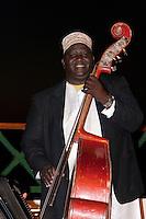 Zanzibar, Tanzania.  Taarab Musicians.  Culture Musical Club. Bass Violin Player.