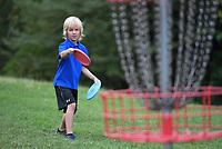 NWA Democrat-Gazette/J.T. WAMPLER Quinn Penticoff, 6, plays at Cedar Creek Disc Golf Course in August 2019.