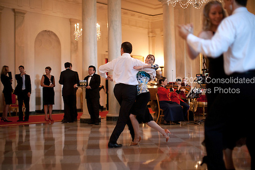 Washington, DC - July 27, 2009 -- Guests dance in the Grand Foyer of the White Hose during the Ambassadors Reception, hosted by President Barack Obama and First Lady Michelle Obama in the White House in Washington on Monday, July 27, 2009. .Mandatory Credit: Lawrence Jackson - White House via CNP
