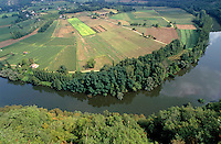 Lot Valley and Lot River surrounded by trees and farms seen from Saut de la Mounine, France.