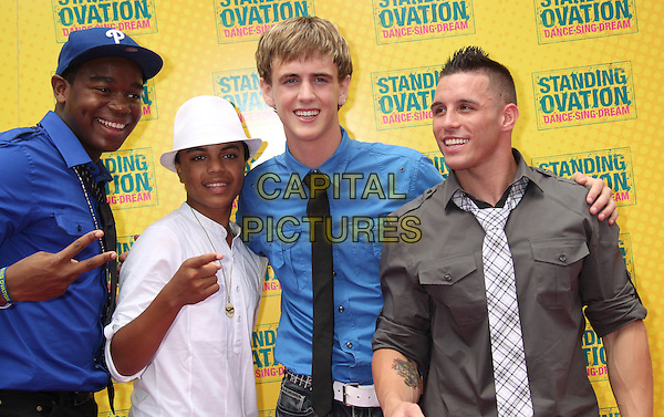 DEXTER DARDEN, MYKAL WILLIAMS, AUSTIN POWELL & MICHAEL PERCOLOSO.'Standing Ovation' Los Angeles Premiere held at Universal CityWalk AMC Theatres, Universal City, CA, USA..July 10th, 2010.half length black white blue brown grey gray tie shirt baseball cap hat hand v peace sign pointing .CAP/ADM/MJ.©Michael Jade/AdMedia/Capital Pictures.