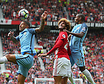 Aleksander Kolarov of Manchester City gets to the ball before Marouane Fellaini of Manchester United during the Premier League match at Old Trafford Stadium, Manchester. Picture date: September 10th, 2016. Pic Simon Bellis/Sportimage