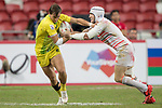 Phil Burgess of England (right) competes for the ball with John Porch of Australia (left) during the match Australia vs England, the Bronze Final of Day 2 of the HSBC Singapore Rugby Sevens as part of the World Rugby HSBC World Rugby Sevens Series 2016-17 at the National Stadium on 16 April 2017 in Singapore. Photo by Victor Fraile / Power Sport Images