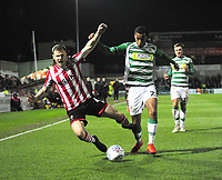 Lincoln City's Michael O'Connor vies for possession with Yeovil Town's Josh Grant<br /> <br /> Photographer Andrew Vaughan/CameraSport<br /> <br /> The EFL Sky Bet League Two - Lincoln City v Yeovil Town - Friday 8th March 2019 - Sincil Bank - Lincoln<br /> <br /> World Copyright © 2019 CameraSport. All rights reserved. 43 Linden Ave. Countesthorpe. Leicester. England. LE8 5PG - Tel: +44 (0) 116 277 4147 - admin@camerasport.com - www.camerasport.com