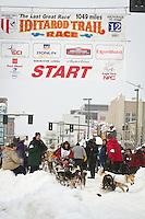 Silvia Furtwängler leaves the 2011 Iditarod ceremonial start line in downtown Anchorage, during the 2012 Iditarod..Jim R. Kohl/Iditarodphotos.com