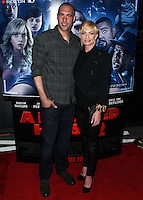 "LOS ANGELES, CA, USA - APRIL 16: Hamzi Hijazi, Jaime Pressly at the Los Angeles Premiere Of Open Road Films' ""A Haunted House 2"" held at Regal Cinemas L.A. Live on April 16, 2014 in Los Angeles, California, United States. (Photo by Xavier Collin/Celebrity Monitor)"