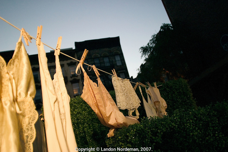 NEW YORK--SEP 10 Vintage lingerie hangs from a clothes-line as part of the decor of the Cynthia Rowley fashion show at the Elizabeth Street Gardens during Olympus Fashion Week Spring 2005 in New York City on September 10, 2004. (Photo by Landon Nordeman/Getty Images)
