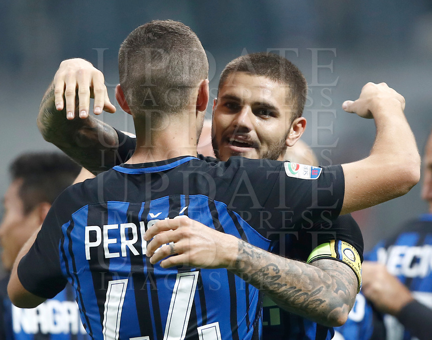 Calcio, Serie A: Milano, stadio Giuseppe Meazza, 15 ottobre 2017.<br /> Inter's Mauro Icardi (r) celebrates with his teammate Ivan Perisic (r) after scoring his second goal during the Italian Serie A football match between Inter and Milan at Giuseppe Meazza (San Siro) stadium, October15, 2017.<br /> UPDATE IMAGES PRESS/Isabella Bonotto