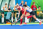 Lily Owsley #26 of Great Britain carries the ball down the sideline pursued by Noel Barrionuevo #27 of Argentina during Argentina vs Great Britain in women's Pool B game  at the Rio 2016 Olympics at the Olympic Hockey Centre in Rio de Janeiro, Brazil.