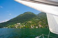 Sailing past Caprino on Lake Lugano, Ticino, Switzerland, july 2013.