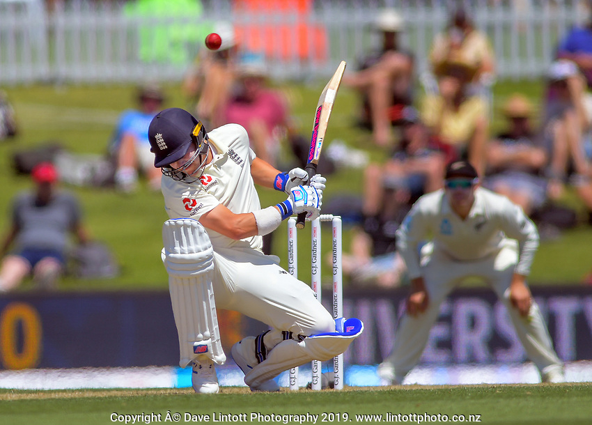 England's Rory Burns ducks a bouncer during day one of the international cricket 1st test match between NZ Black Caps and England at Bay Oval in Mount Maunganui, New Zealand on Thursday, 21 November 2019. Photo: Dave Lintott / lintottphoto.co.nz