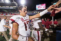 NWA Democrat-Gazette/BEN GOFF @NWABENGOFF<br /> Nick Starkel, Arkansas quarterback, hands his head band to fans after the game Saturday, Sept. 7, 2019, at Vaught-Hemingway Stadium in Oxford, Miss.