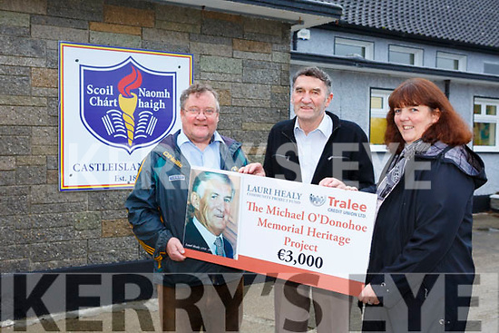 Helen Geary (Tralee Credit Union) presenting Colm Kerwin (Sec) and John Roche (Chairman of the Michael O'Donohue Memorial Heritage Project) with a cheque for €3,000 from the Lauri Healy Community Project fund at the Castleisland Boys National School on Friday.