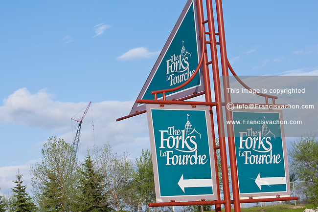 The Forks (La Fourche) sign is pictured in Winnipeg Sunday May 22, 2011. The Forks is a historic site and meeting place in Downtown Winnipeg located at the confluence of the Red River and Assiniboine River that now hosts the Forks Market, Manitoba Theatre for Young People, a Skatepark, the World's longest skating rink, and the under construction Canadian Museum for Human Rights.