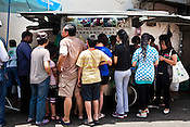 Customers wait for their turn to eat chendol at Penang's famous Teo Chew Chendol cart in Georgetown of Penang, Malaysia. Photo: Sanjit Das/Panos