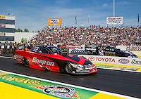 Jun. 1, 2014; Englishtown, NJ, USA; NHRA funny car driver Cruz Pedregon (near) races alongside Jack Beckman during the Summernationals at Raceway Park. Mandatory Credit: Mark J. Rebilas-