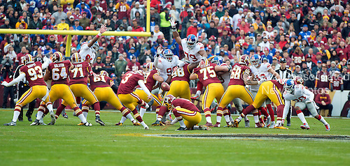 New York Giants defensive tackle Jay Bromley (96), and defensive tackle Montori Hughes (79) leap to block an attempted field goal by Washington Redskins kicker Dustin Hopkins (3) in the first quarter at FedEx Field in Landover, Maryland on Sunday, November 29, 2015.  Bromley got credit for blocking the kick.<br /> Credit: Ron Sachs / CNP<br /> (RESTRICTION: NO New York or New Jersey Newspapers or newspapers within a 75 mile radius of New York City)
