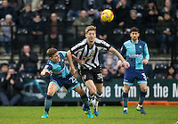 Dominic Gape of Wycombe Wanderers & Jonathan Stead of Notts Co battle during the Sky Bet League 2 match between Notts County and Wycombe Wanderers at Meadow Lane, Nottingham, England on 10 December 2016. Photo by Andy Rowland.