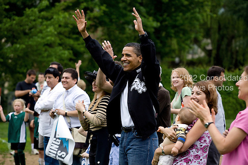 Washington, DC - May 16, 2009 -- United States President Barack Obama cheers for his daughter Sasha's soccer team at a park in the Georgetown area of Washington, May 16, 2009..Mandatory Credit: Pete Souza - White House via CNP