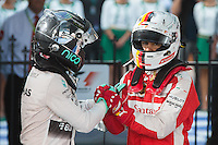 March 15, 2015: Nico Rosberg (DEU) #6 from the Mercedes AMG Petronas F1 Team and Sebastian Vettel (DEU) #5 from the Scuderia Ferrari team congratulate each other after coming 2nd and 3rd at the 2015 Australian Formula One Grand Prix at Albert Park, Melbourne, Australia. Photo Sydney Low
