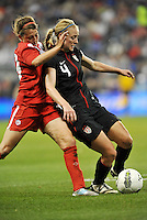 USWNT defender Becky Sauerbrunn (4) holds off a challenge.....USWNT played to a 1-1 tie with Canada at LIVESTRONG Sporting Park, Kansas City, Kansas.