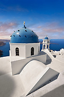 Traditional blue domed Greek Orthodox church of Imerovigli, Island of Thira, Santorini, Greece.
