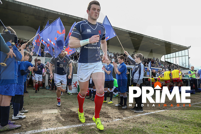 London Scottish players enter the pitch ahead of the Greene King IPA Championship match between London Scottish Football Club and Bristol Rugby at Richmond Athletic Ground, Richmond, United Kingdom on 2 April 2016. Photo by David Horn.