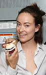 Olivia Wilde from the cast of Broadway's '1984' celebrate their 101st performance (in honor of the show's notorious Room 101) with red velvet cupcakes with severed finger toppings on September 17, 2017 at the Hudson Theatre in New York City.