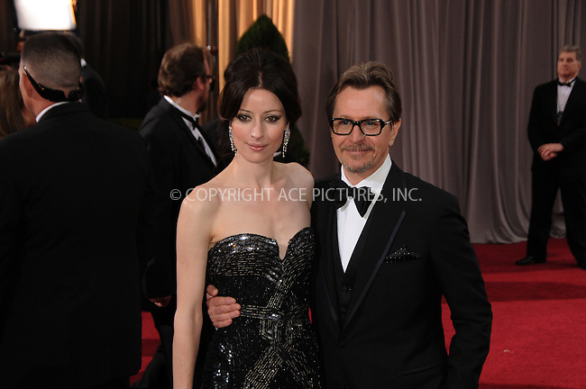 WWW.ACEPIXS.COM . . . . .  ....February 26 2012, LA....Actor Gary Oldman (R) and Alexandra Edenborough arriving at the 84th Annual Academy Awards at the Hollywood & Highland Center on February 26, 2012 in Hollywood, California....Please byline: PETER WEST - ACE PICTURES.... *** ***..Ace Pictures, Inc:  ..Philip Vaughan (212) 243-8787 or (646) 769 0430..e-mail: info@acepixs.com..web: http://www.acepixs.com