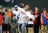 "April 13, 2009: Clemson head football coach Dabo Swinney throws out the ceremonial first pitch before Monday night's 2009 Greenville Drive opening game. Swinney said Clemson football player C.J. Spiller had sent him a text message before the game, imploring him ""Don't pull your hamstring"" when throwing the ball.  Photo by: Tom Priddy/Four Seam Images"