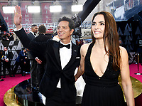 Benjamin Bratt, left, and Talisa Soto arrive at the Oscars on Sunday, March 4, 2018, at the Dolby Theatre in Los Angeles. (Photo by Charles Sykes/Invision/AP)