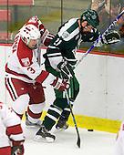 Alex Biega (Harvard - 3), Nick Walsh (Dartmouth - 21) - The Harvard University Crimson defeated the Dartmouth College Big Green 4-1 (EN) on Monday, January 18, 2010, at Bright Hockey Center in Cambridge, Massachusetts.