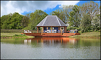 BNPS.co.uk (01202 558833)<br /> Pic:  KnightFrank/BNPS<br /> <br /> Summerhouse...<br /> <br /> A stunning new Arts and Crafts style country manor which comes with its own lake, swimming pool, tennis court and summer house has come on to the market for £4.95million.<br /> <br /> Recently built Thakeham Manor, which also has a helipad, is set in 16 acres of landscaped parkland near Pulborough, West Sussex.<br /> <br /> Its eye-catching design, inspired by the famous early 20th century architect Edwin Lutyens, includes a slate roof, stone quoins and brick buttresses, while inside it is full of glamorous modern touches.<br /> <br /> The luxurious property has five bedrooms, five bathrooms and six reception rooms, and its grounds contain a heated swimming pool and decking area, a circular cushioned seating area and a tennis court.
