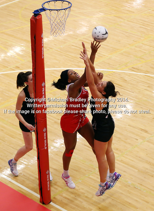 28.10.2014 Silver Ferns Jodi Brown and England's Eboni Beckford-Chambers in action during the Silver Ferns V England netball match played at the Rotorua Events Centre in Rotorua. Mandatory Photo Credit ©Michael Bradley.