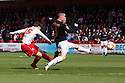 Luke Freeman of Stevenage shoots past Shaun Williams of MK Dons to a header. Stevenage v MK Dons - npower League 1 -  Lamex Stadium, Stevenage - 27th April, 2013. © Kevin Coleman 2013. ..
