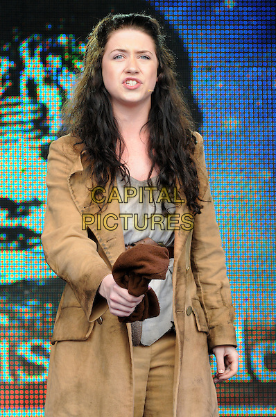 Les Miserables - Danielle Hope.West End Live at Trafalgar Square, London, England..June 24th 2012.on stage performance performing music half length beige jacket mouth open singing .CAP/PP/BK.©Bob Kent/PP/Capital Pictures.