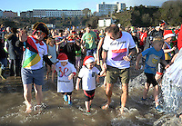 Pictured: People take to the freezing cold sea in Tenby, west Wales, UK. Monday 26 December 2016<br /> Re: Hundreds of people in fancy dress, take part in this year's music-themed charity event, the Boxing Day Swim in Tenby, Pembrokeshire, Wales, UK
